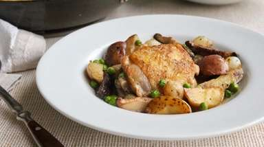 Chicken thighs, shiitake mushrooms, peas and potatoes cook
