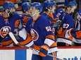Islanders left wing Ross Johnston greets teammates after