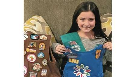 Kidsday reporter Alexandra Piccoro with her Girl Scout