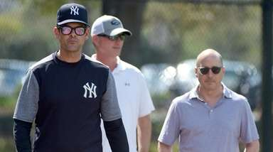 From left, Yankees manager Aaron Boone, VP of