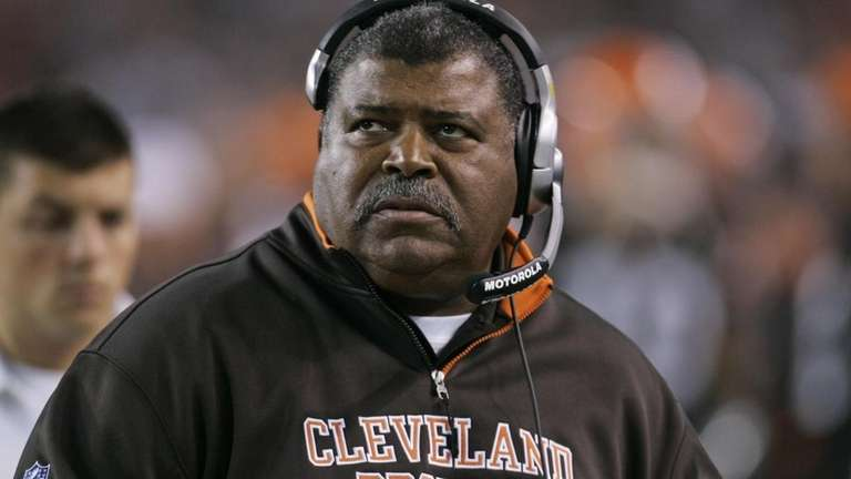 Cleveland Browns coach Romeo Crennel watches from the