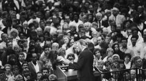 Rev. Billy Graham preaches to a crowd at