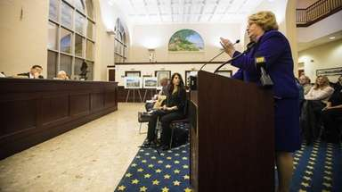 Susan Britt of Glen Cove speaks at a