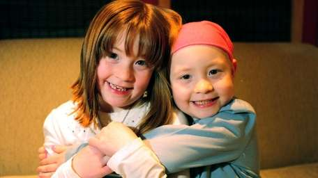 Jessica Buttner, left, with her twin sister, Julianna,