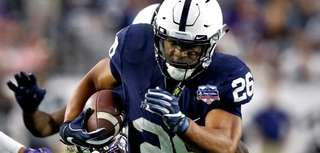Penn State running back Saquon Barkley (26) carries