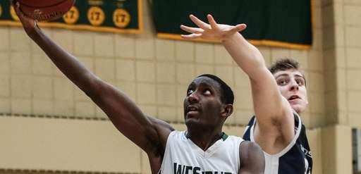 Isaiah Bien-Aise of Westbury takes the layup in