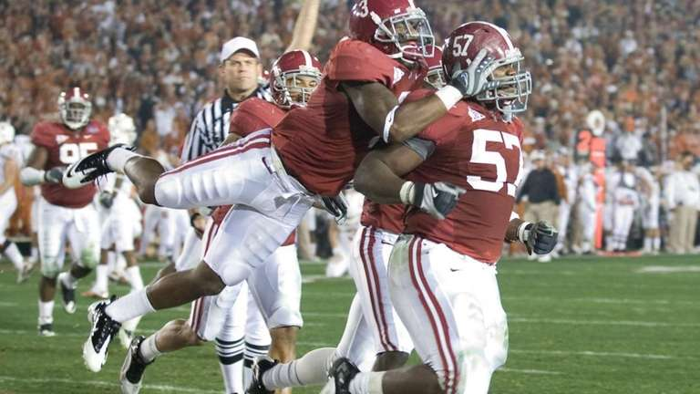 Alabama's Marcell Dareus, right, celebrates his touchdown after
