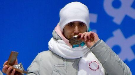 Russia's bronze medallist Aleksandr Krushelnitckii during medal ceremony