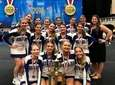 Hauppauge cheerleaders pose with second-place trophy at UCA