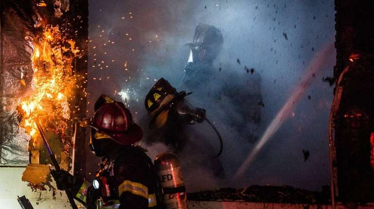 The Lindenhurst Fire Department battles a house fire