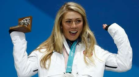 Mikaela Shiffrin celebrates during the medals ceremony at