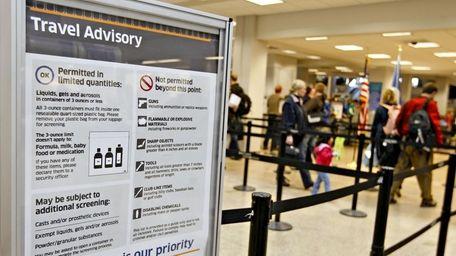 A Transportation Safety Administration (TSA) travel advisory stands