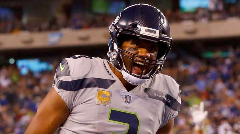 Seahawks quarterback Russell Wilson reacts after throwing a
