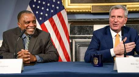 J. Phillip Thompson, left, was appointed Thursday as