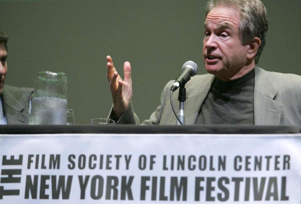 Director Warren Beatty speaks during a news conference