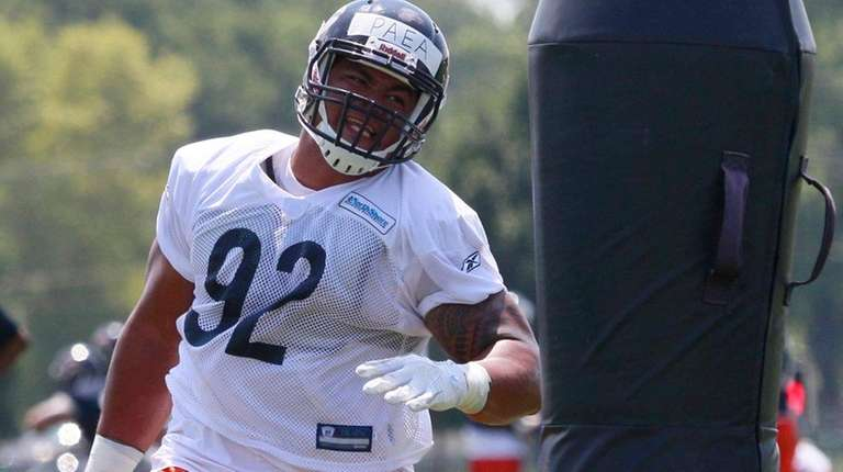 Chicago Bears' Stephen Paea works out during training