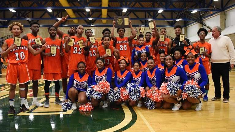 Malverne players, coaches and cheerleaders pose for a