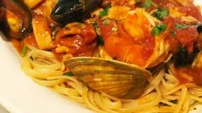 Linguine with seafood in a red sauce at