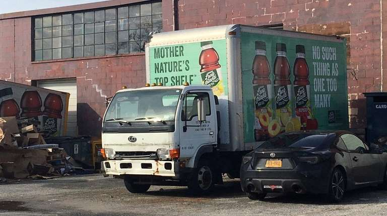 A Long Island Iced Tea delivery truck sits