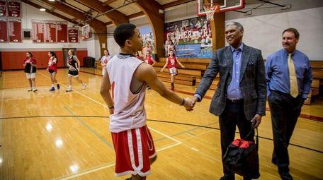Knicks president Steve Mills greets a student at