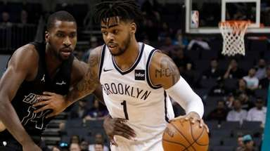 The Nets' D'Angelo Russell tries to get by