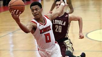 Knox's Quinto Williams catches a full court pass