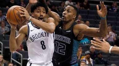 The Nets' Spencer Dinwiddie looks to pass the ball