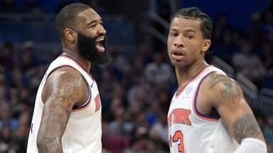 Knicks center Kyle O'Quinn, left, and guard Trey
