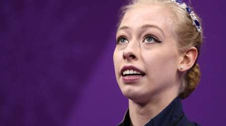 Bradie Tennell reacts after competing during the women's