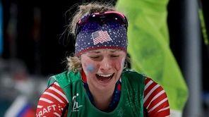 Jessica Diggins celebrates after winning the gold medal