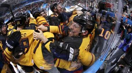 Germany players celebrate after the semifinal round of