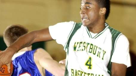 Westbury's Sheldon Hagigal (4, right), feeds the ball