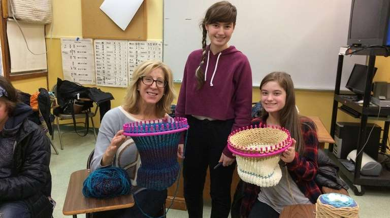 Heather Millman, center, spearheaded a Hat Loom Club