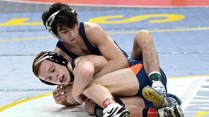 Rocky Point's Anthony Sciotto, top, wrestles David Traub