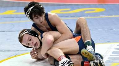 Rocky Point's Anthony Sciotto, top, wrestles David Traub