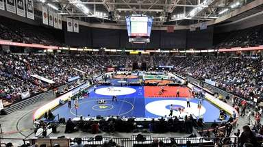 Wrestlers compete in the quarterfinal of the NYSPHSAA