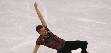Adam Rippon reacts after his recent routine during