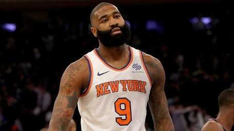Kyle O'Quinn of the Knicks reacts after aloss
