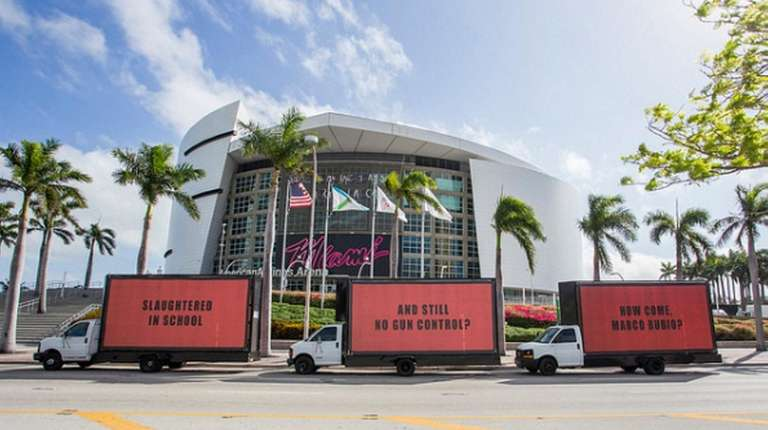 Three mobile billboards in Miami calling for gun