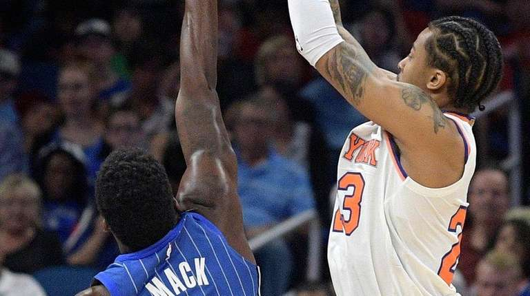 Knicks guard Trey Burke goes up for a