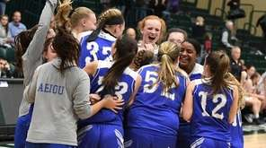 Hauppauge players celebrate their 51-40 victory against Mt