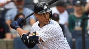 Giancarlo Stanton bats during his first Yankees spring