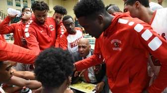 Amityville head coach Gordon Thomas directs his players
