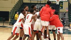 Amityville players celebrate their 83-66 win against Westhampton