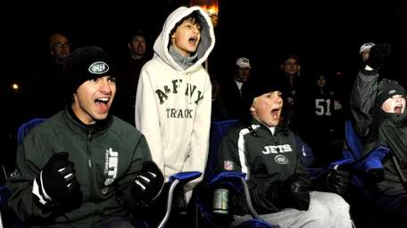 Excited Jets fans Jesse Farinacci, left, William Haring,