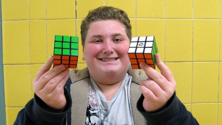 Kidsday reporter Jake Moldowsky holds two Rubik's Cubes.