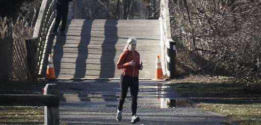 A woman jogs at Sunken Meadow State Park