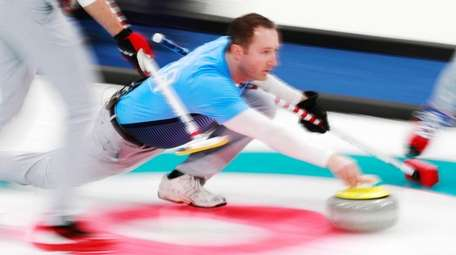 John Shuster of the US in action during
