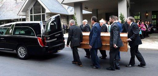 Pallbearers carry the body of Rev. Billy Graham