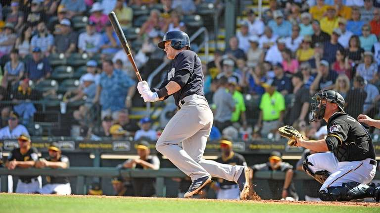 The Yankees' Clint Frazier knocks a single during